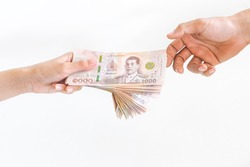 Hand holding Thai money on a white background, the concept of the Covid-19 economy.