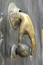 Hand holding the apple as a door bell
