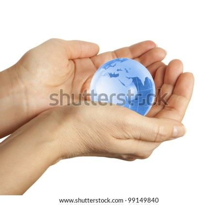 Hand holding the blue Earth