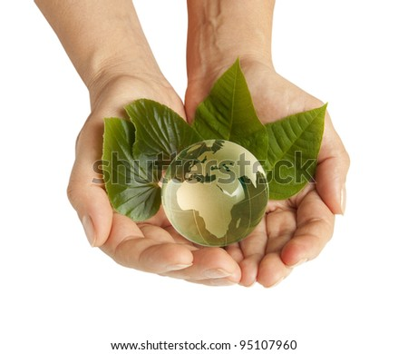 Hand holding the green Earth isolated