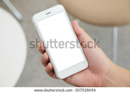 hand holding the smartphone with blank screen #307028696