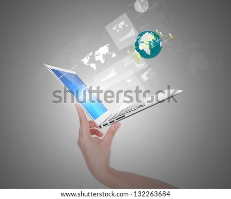 Hand holding thin laptop with screen and graph,social network out
