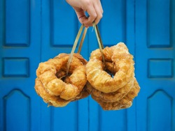 Hand holding traditional fresh baked donuts in Morocco