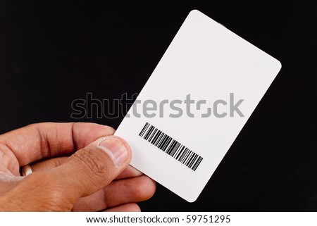 Hand Holding Up Security Clearance Card