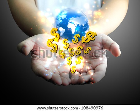 hand holding US dollar with world