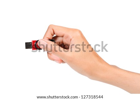 Hand holding USB device on white background