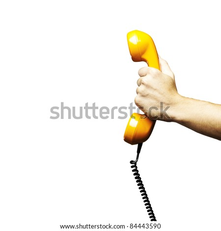 Hand holding vintage telephone receiver isolated over white background
