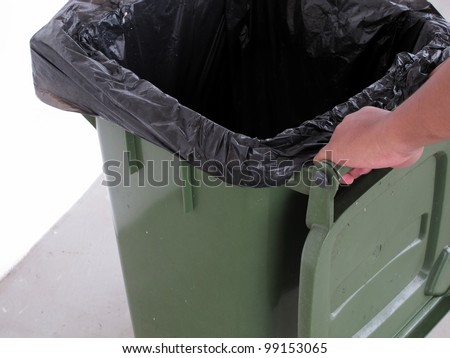 Hand holding waste container - stock photo