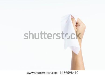 Hand holding wet wipes tissue on white background