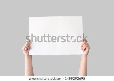 hand holding white blank paper isolated on grey background with clipping path Stock photo ©