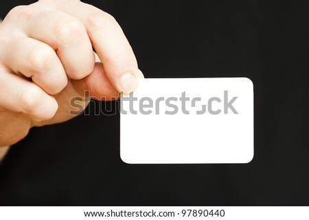 hand holding white business card on black background, See my portfolio for more