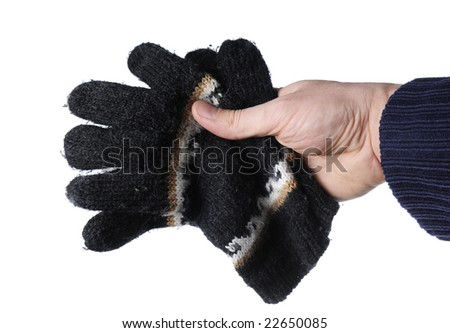 hand holding winter gloves over white background