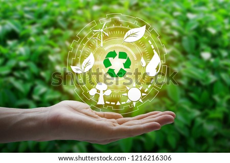 Hand holding with environment Icons over the Network connection on nature background, Technology ecology concept. #1216216306