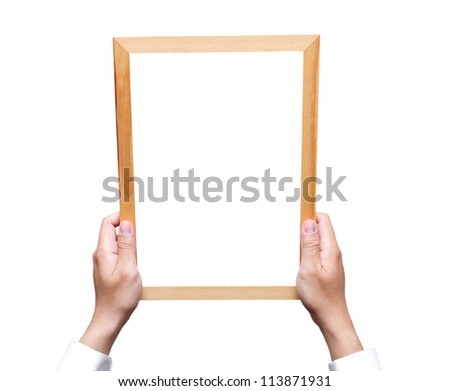 Hand holding  wooden frame isolated on white
