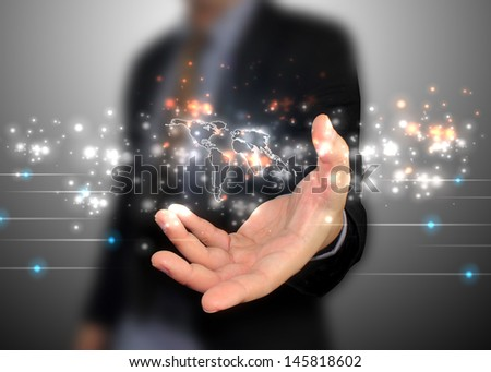 hand holding world map - stock photo