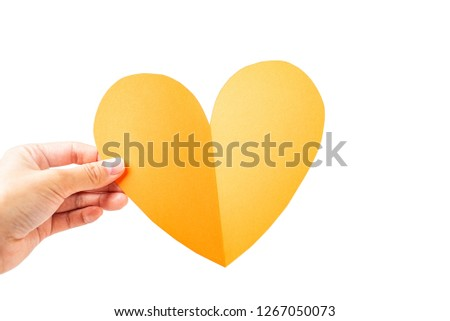 Hand holding yellow heart love heart shaped concept poster #1267050073