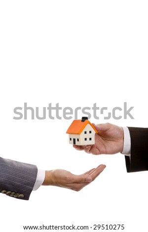 hand holdinh a small house - real state house credit concept