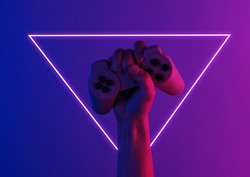 Hand holds a gamepad with pink blue neon light. Minimalism, concept art 80s
