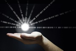 Hand holds a glowing ball emitting datastreams