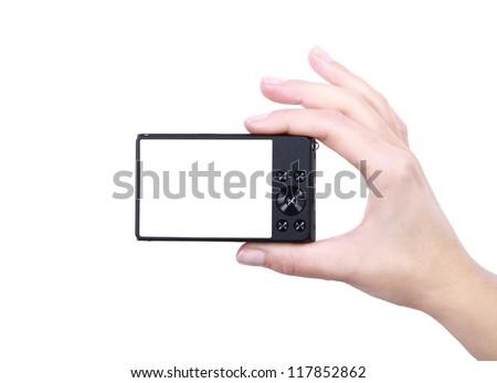Hand holds digital camera. Isolated on white background