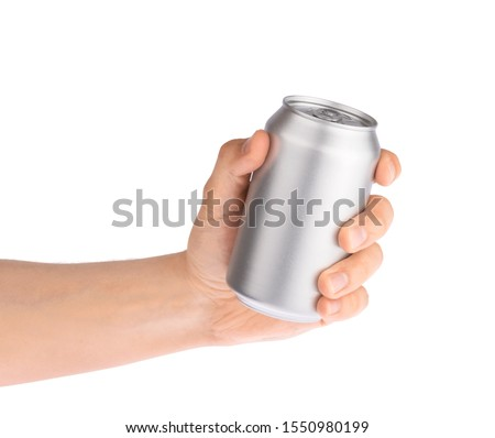 Hand holds metal beverage drink can isolated on white