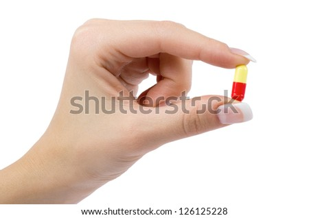hand holds pill isolated on white