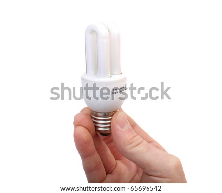hand holds the lamp electrical economical white