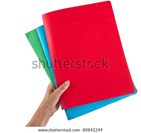 Hand holds three business document folders - isolated over white