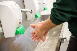 Hand Hygiene and Food Safety. Factory worker washing hands. coronavirus protection
