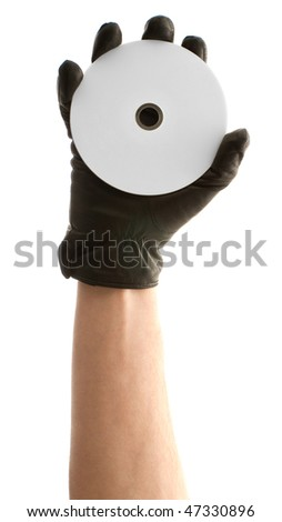 Hand in black glove holding cd or dvd disk isolated on white background