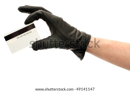 Hand in black leather glove holding credit card, isolated on white background