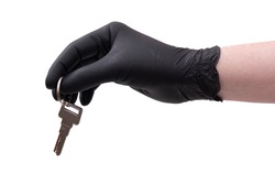 Hand in black leather glove with key isolated on white background