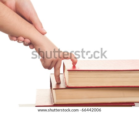hand in hand, the adult helps the child to walk up the steps of the books