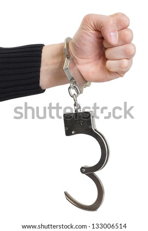 Hand in handcuffs squeezed in a fist.