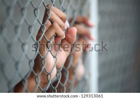 hand in jail.