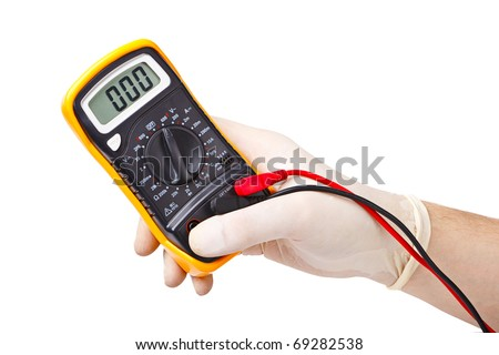 Hand in rubber glove holding an electronic tester
