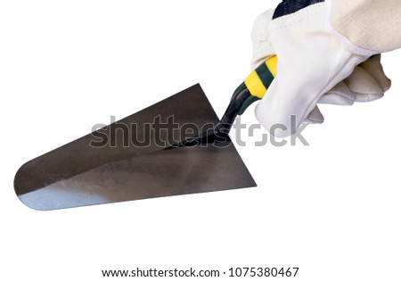 hand in the construction worker glove hold the trowel. close-up