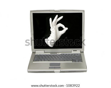 Hand in white fabric glove showing OK sign on the laptop screen