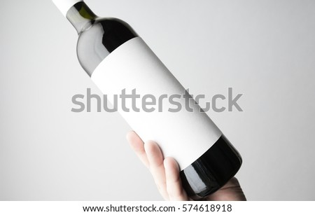 Hand is holding wine bottle/Close-up #574618918