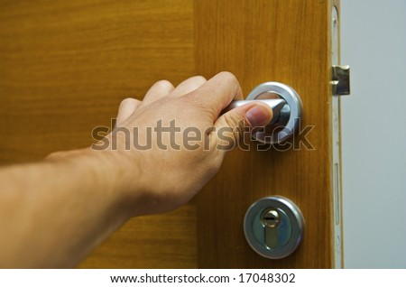 Hand it is discovered the door - stock photo