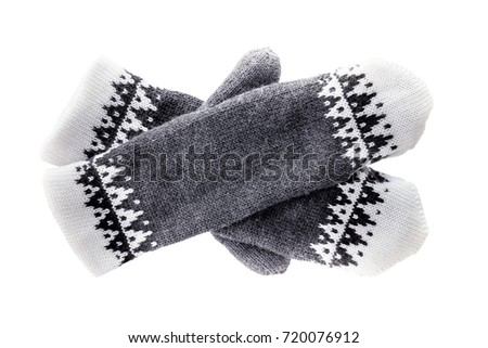 Hand-knitted mittens isolated on white background. #720076912