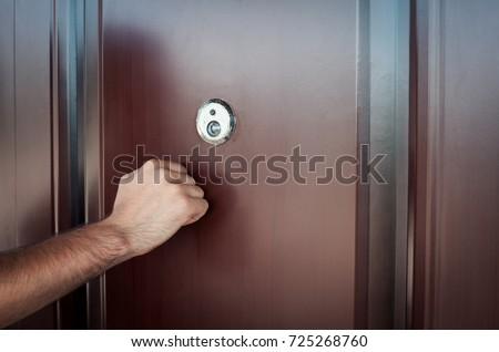 Hand knocking on door. Foto d'archivio ©