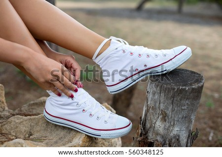 hand knotted laces white sneakers on nature
