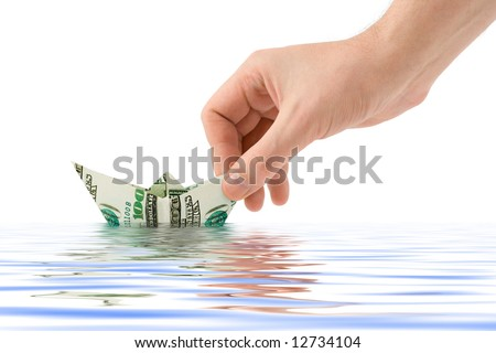 Hand launching money ship, isolated on white background