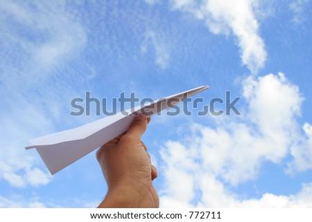 Hand launching paper airplane