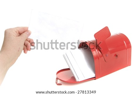 Hand lifts envelope or bill from  full mailbox