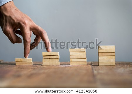 Hand liken business person jump a toy staircase to success, business concept #412341058