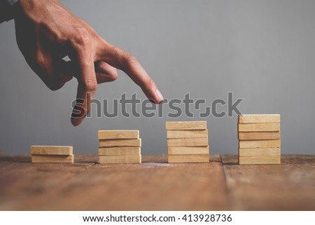 Hand liken business person jump a toy staircase to success, business concept #413928736