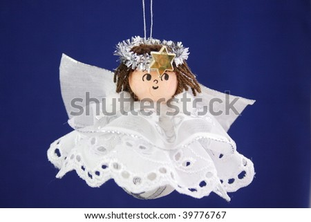 hand made christmas decoration angel child on the blue background - Porky Pig Blue Christmas Wikipedia