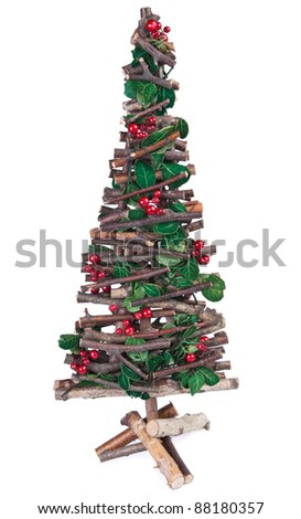 Hand made christmas tree with holly and red berries